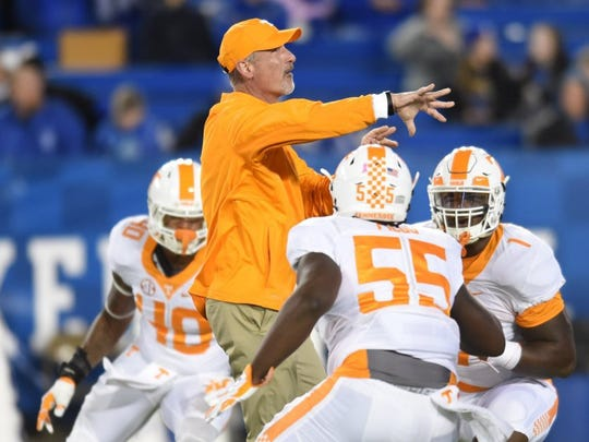 Tennessee defensive coordinator John Jancek warms up with players before the game against Kentucky at Commonwealth Stadium in Lexington, Ky., on Saturday, Oct. 31, 2015. (ADAM LAU/NEWS SENTINEL)