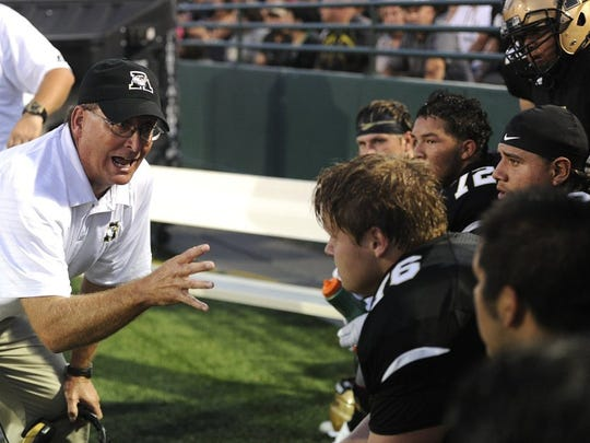 Abilene High head coach Del Van Cox talks to his players on the bench during the first quarter of an Eagles game in 2016, a year prior to becoming his son's head coach in 2017.