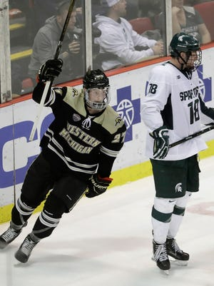 Western Michigan forward Wade Allison (27) raises his arm after a teammate scored during the second period of a Great Lakes Invitational college hockey game against Michigan State, Thursday, Dec. 29, 2016, in Detroit.