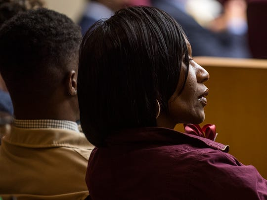Zenobia Dobson, right, listens during her son Zaevion Dobson's slaying trial at Knox County Criminal Court on Tuesday, Dec. 5, 2017.