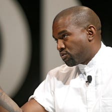 Kanye West American rapper, songwriter, record producer, film director, entrepreneur, and fashion designer, Kanye West attends the Cannes Lions 2014, 61st International Advertising Festival in Cannes, southern France, Tuesday, June 17, 2014. The Cannes Lions International Advertising Festival is a world's meeting place for professionals in the communications industry.(AP Photo/Lionel Cironneau)