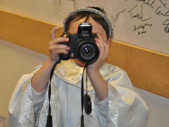 A little angel takes a few photos of his own at a previous   year's performance.