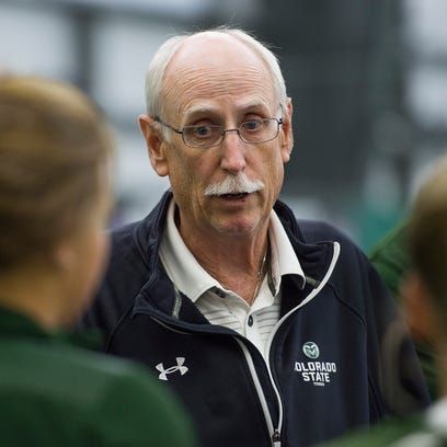 Coach Jon Messick chats with the CSU tennis team before