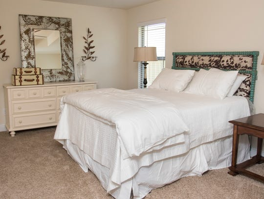 The master bedroom of a Adams Homes model house in