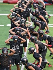 St. Cloud State players complete a tackling drill during practice Thursday, Aug. 11, at Husky Stadium in St. Cloud.