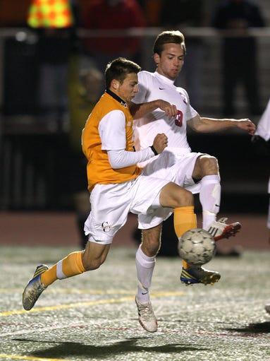 Chuchville-Chili's Alex Siracusa (21) and Fairport's Alex Mangerian (3) battle.