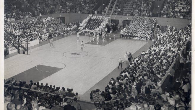 Eaton battles Harrison in a 1960 sectional game at the Muncie Fieldhouse.