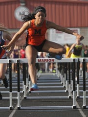 Mansfield Senior's Alaya Grose, who recently signed with Ohio University, won the 100 hurdles and the 100 dash back-to-back in Friday's Marion Night Invitational.