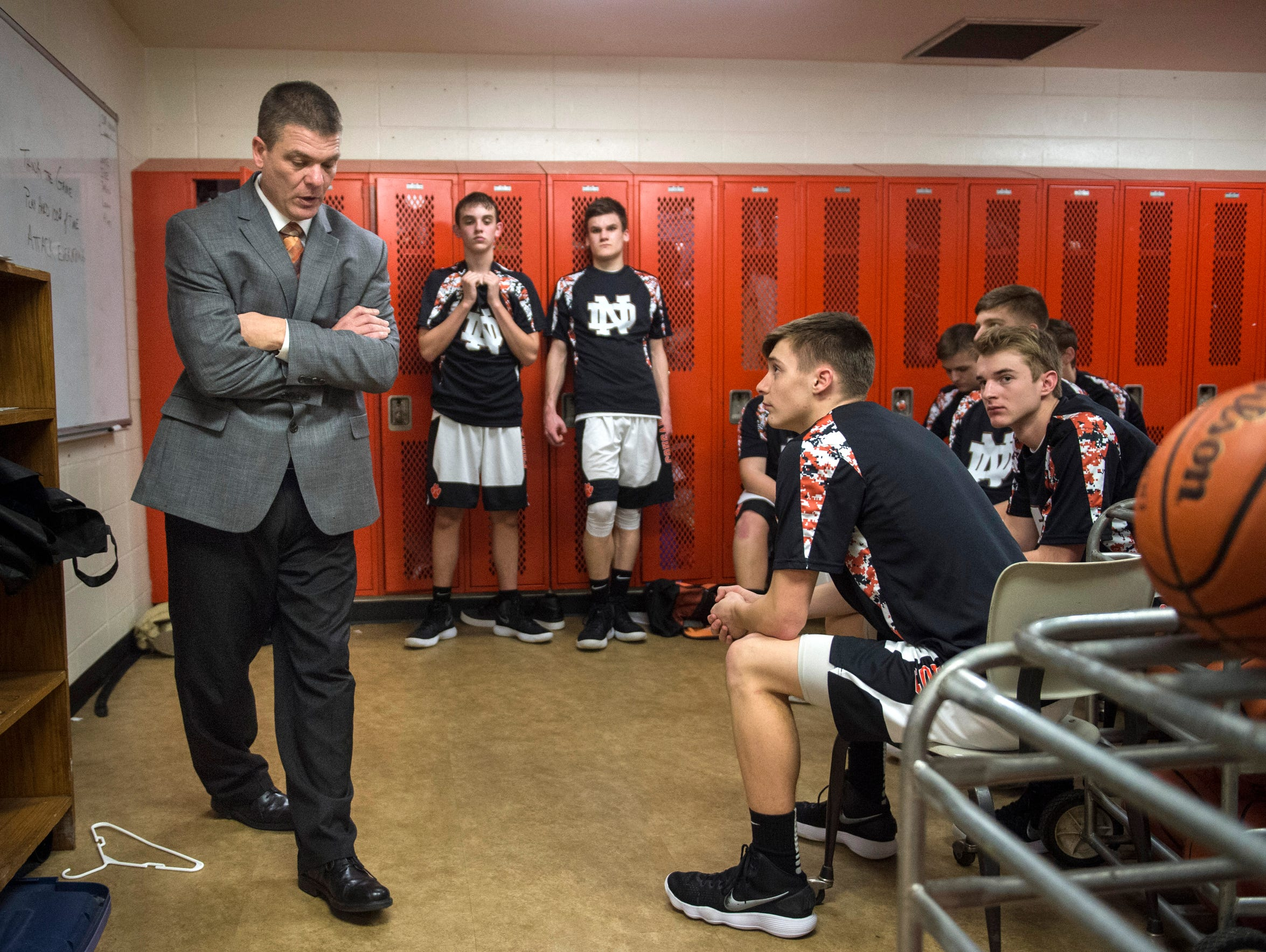 North Daviess head coach Brent Dalrymple talks to his team in the locker room before taking on White River Valley at North Daviess High School on Friday, Feb. 16, 2018.