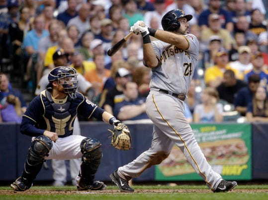 Pittsburgh Pirates' Pedro Alvarez watches his three-run home run during the fourth inning of a baseball game against the Milwaukee Brewers on Saturday, Aug. 23, 2014, in Milwaukee. (AP Photo/Morry Gash)