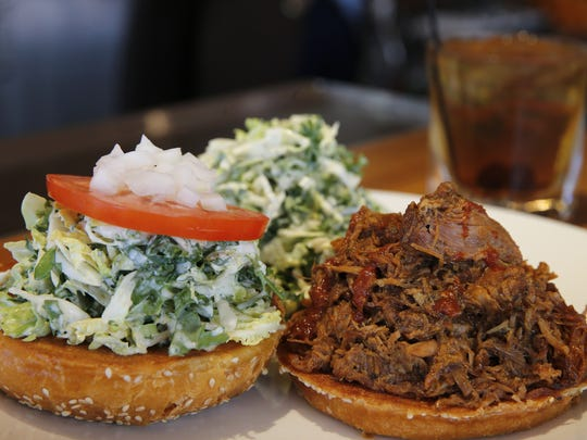 BBQ Pork Sandwich, slow-cooked Niman Ranch pulled pork, topped with barbeque sauce, slaw, tomato and onion with classic coleslaw by Northstar Cafe at Liberty Center. Photo shot Monday June 13, 2016.