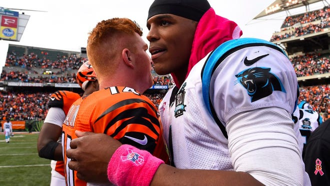 Oct 12, 2014; Cincinnati, OH, USA; Carolina Panthers quarterback Cam Newton (1) hugs Cincinnati Bengals quarterback Andy Dalton (14) after their game at Paul Brown Stadium. The Bengals and the Panthers tie in overtime 37-37. Mandatory Credit: Mike DiNovo-USA TODAY Sports ORG XMIT: USATSI-180178 ORIG FILE ID:  20141012_ads_ad4_268.JPG