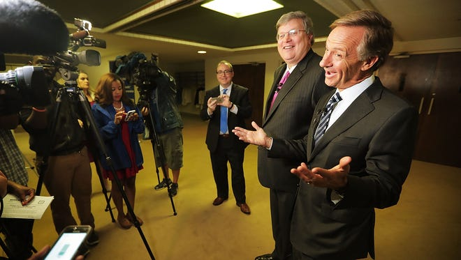 Gov. Bill Haslam jokes with the media during a visit with Memphis Mayor Jim Strickland to visit Greenwood CME Church.