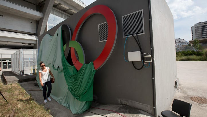 A canvas covers the Olympic rings at Maracana stadium