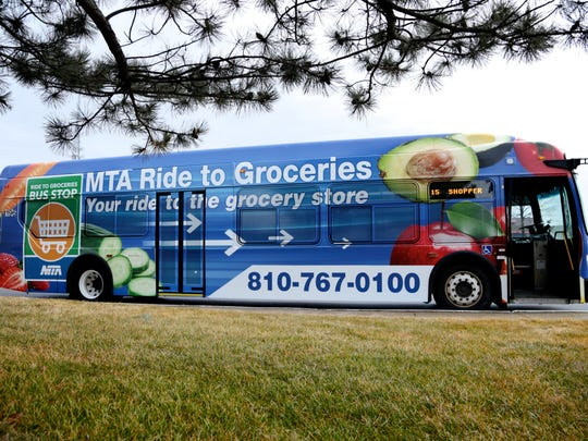 The new Ride to Groceries bus is seen on Tuesday, February 2, 2016, in Flint, MI. The bus service takes residents to three grocery stores on the outskirts of city of Flint.