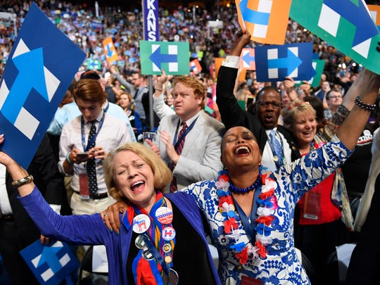 Hillary Clinton supporters from Arkansas cheer during the 2016 Democratic National Convention in Philadelphia.