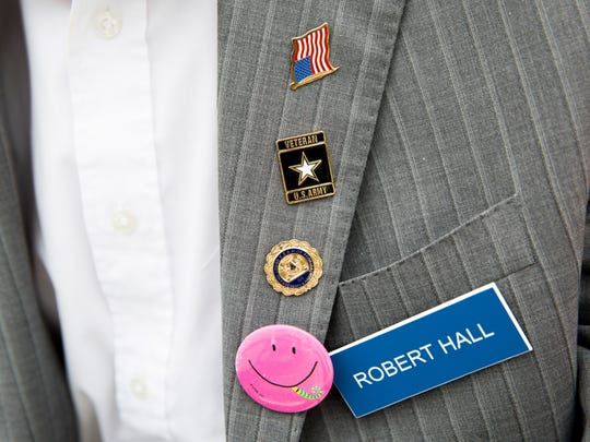 Pins adorn the suit jacket of World War II veteran Bob Hall after celebrating his 100th birthday with members of his congregation at First Congregational Church on Sunday, June 11, 2017, in North Naples.