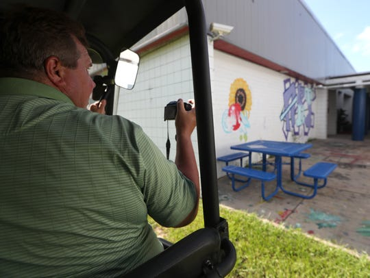 Leon County Sheriff Deputy Dean Crump takes photos,