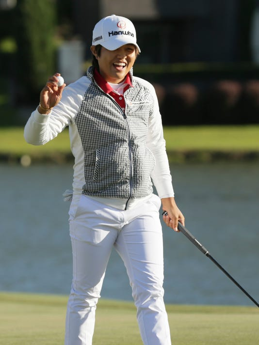 Haru Nomura, of Japan, reacts to sinking a putt on the 18th hole to force playoff holes against Christie Kerr during the LPGA Texas Shootout golf tournament in Irving, Texas, Sunday, April 30, 2017. (AP Photo/LM Otero)