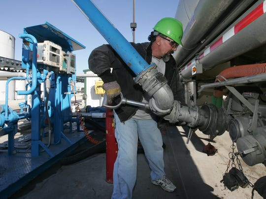 In this 2009 file photo, Bill Heiden fills his truck at Lincolnway Energy ethanol plant in Nevada on his way to Des Moines.