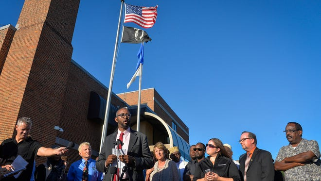 Jaylani Hussein, executive director of Council on American-Islamic Relations in Minnesota, is joined by representatives of UniteCloud, Christian churches and members of the Somali community Monday, Sept. 19, as he speaks at a press conference outside St. Cloud City Hall. The conference was to address the current mood in the community and to call for peace and unity.