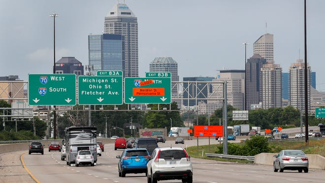 Commuters drive into downtown via I-70 westbound. Construction has begun on I-65 between 21st Street to Meridian Street through downtown Indianapolis on July 2, 2018.