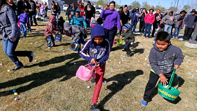 Participants in the 5 to 7-year-old group race to grab eggs April 3, 2015, during the Easter EGGStravaganza at the Sycamore Park Community Center in Farmington.
