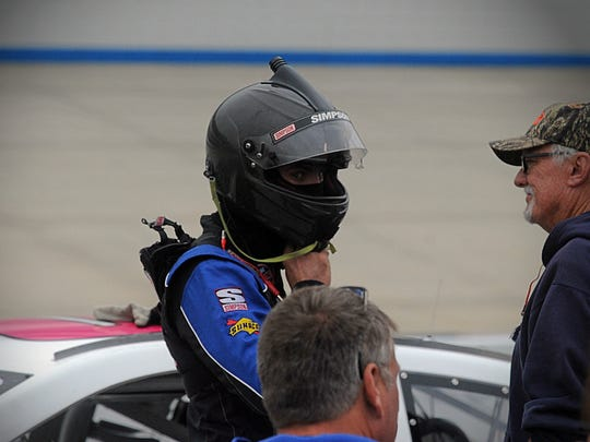 Cordova's Tyler Hughes buckles up his helmet before a practice run at Dover's Monster Mile on Friday, Sept. 30, 2016.