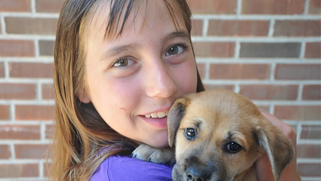 Sophia Pruitt fosters animals for IndyHumane. She has raised more than $12,000 for the organization.