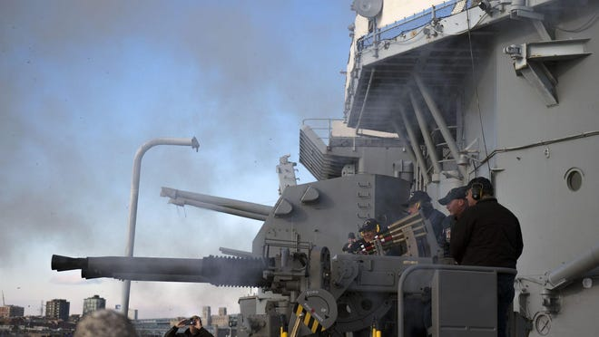 Smoke clears from a restored 40mm anti-aircraft gun as it is fired during a ceremony commemorating the 75th anniversary of the USS New Jersey's launch on Dec. 7, 2017, in Camden.
