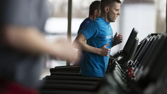 Andy Tempest runs on a treadmill in the new expansion at the Eastside Family Branch YMCA in Penfield on Saturday, March 28, 2015.