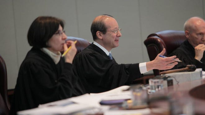 In a photo from April 2012, New Jersey Supreme Court Associate Justice Jaynee LaVecchia, left, Chief Justice Stuart Rabner, center, and Associate Justice Barry Albin listen to testimony.