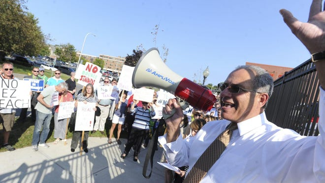 "A NYSUT rally, led by Andy Pallotta, union president. The New York State United Teachers filed a lawsuit stating that 20% reductions in education aid that have been outlined by Gov. Andrew Cuomo would be ""devastating,"" particularly to needier districts that rely heavily on state aid."