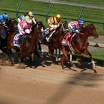 The race horses head down the first stretch during the 141st running of the Kentucky Derby. May 2, 2015