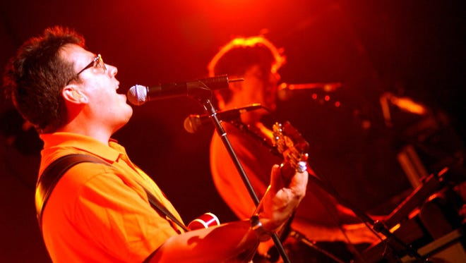 John Flansburgh, left, and John Linnell of the musical group They Might Be Giants perform at the John Anson Ford Theater in Los Angeles July 26, 2002.