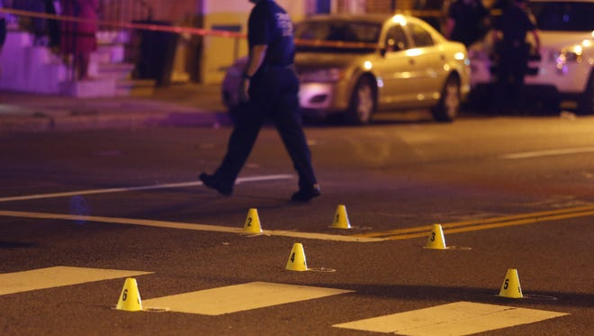 Evidence markers fill the roadway as Wilmington police investigate a shooting at the intersection of W. 4th and Adams Streets in Wilmington in August 2014.