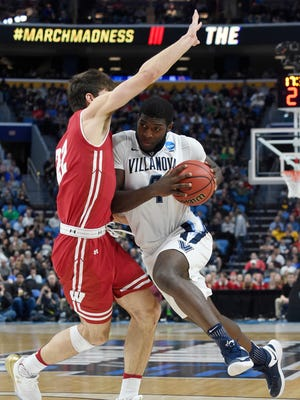 Villanova Wildcats forward Eric Paschall (4) drives to the basket against Wisconsin Badgers forward Ethan Happ (22) in the second half during the second round of the 2017 NCAA Tournament at KeyBank Center.