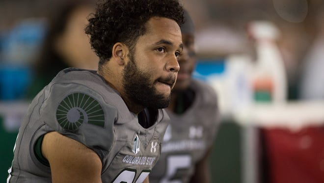 CSU defensive back Justin Sweet watches the final moments in a game against Wyoming at Hughes Stadium. CSU lost 38-17 against the Cowboys.