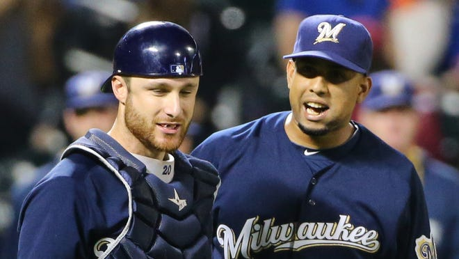 Brewers relief pitcher Francisco Rodriguez (57) and catcher Jonathan Lucroy (20) celebrate the win.