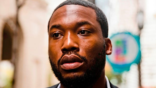 Rapper Meek Mill arrives at the Criminal Justice Center in Philadelphia. Pennsylvania's highest court has ordered a judge to free rapper Meek Mill on bail while he appeals decade-old gun and drug convictions.