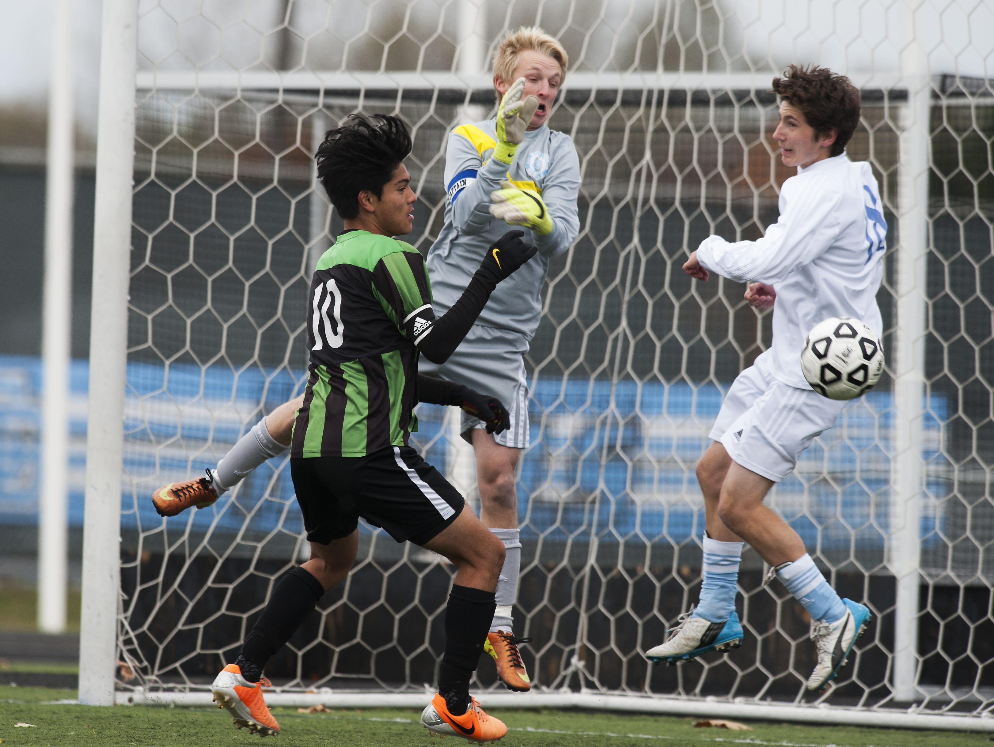 South Burlington goalie Tyler Ayers (0) makes a save during a Division I high school boys soccer quarterfinal Saturday.