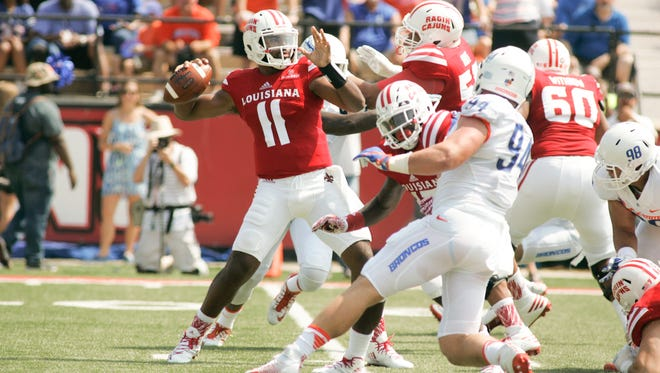 New UL quarterback Anthony Jennings (11) was under heavy pressure from Boise State all day Saturday in a 45-10 loss to the Broncos.