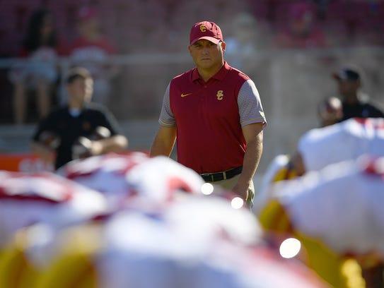 Head coach Clay Helton of the USC Trojans looks on