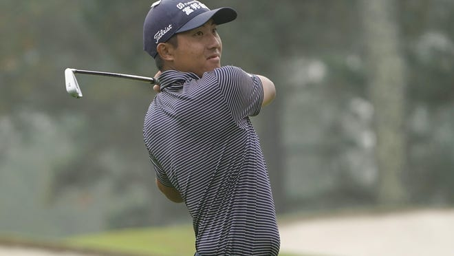 C.T. Pan plays his shot from the third tee during the final round of the Masters Tournament on Sunday.