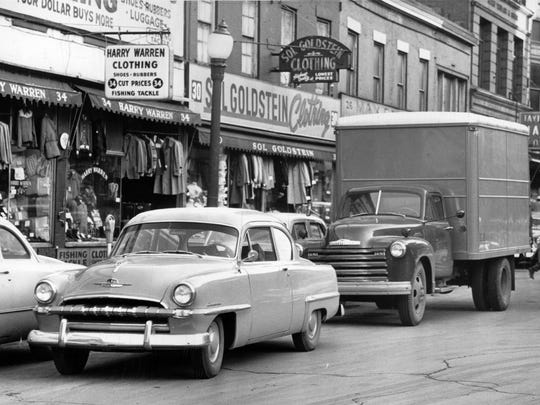 Double parking ties up traffic on Front Street in this 1953 photo.