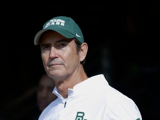 FILE - In this Dec. 5, 2015, file photo, Baylor coach Art Briles stands in the tunnel before the team's NCAA college football game against Texas in Waco, Texas. The former Baylor football coach has dropped the defamation lawsuit filed against four university officials he accused of making false statements against him, according to attorneys in the case.    Briles in December sued the three regents and a university vice president for libel and slander, claiming they falsely stated that he knew of reported assaults and alleged gang rapes by players and didn't report them.  (AP Photo/LM Otero, File)