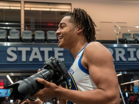 September 30, 2019; San Francisco, CA, USA; Golden State Warriors guard Jordan Poole (3) takes a media photographer's camera during Media Day at Chase Center. Mandatory Credit: Kyle Terada-USA TODAY Sports