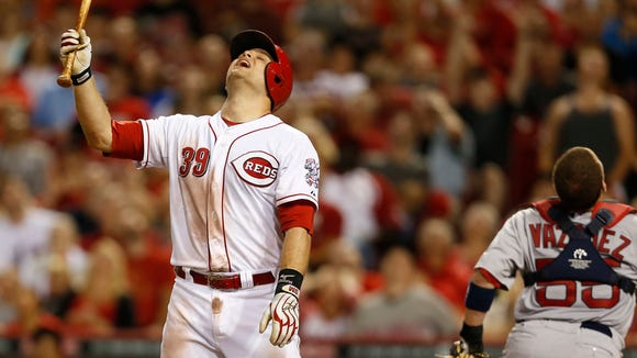Reds catcher Devin Mesoraco (39) reacts to fouling out to Boston Red Sox catcher Christian Vazquez (55) to end the eighth inning at Great American Ball Park.