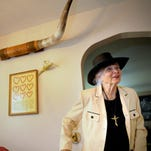 Rhea Woltman's classic car collection includes a red 1959 Cadillac coupe.