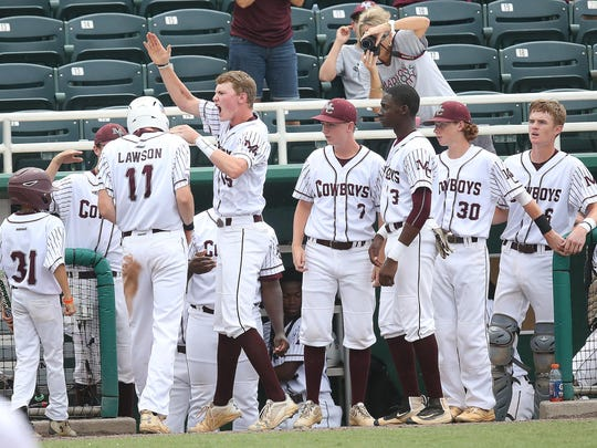 Madison County players celebrate Dilan Lawson's game-tying run in the fourth inning during a 3-2 loss to Trenton on Thursday in the Class 1A state championship in Fort Myers.
